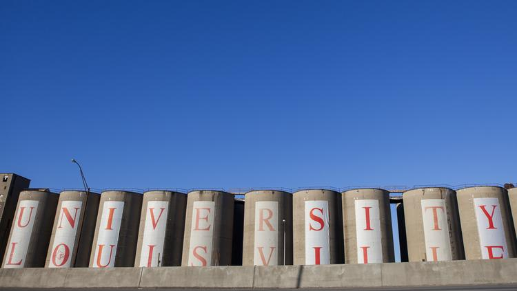 Twenty-two silos along Interstate 65 near the University of Louisville's Belknap campus are being demolished.