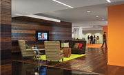 The reception area features reclaimed wood floor from a pre-Civil War munitions factory.