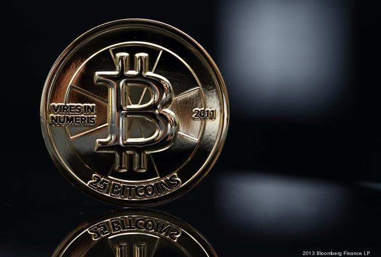 Bloomberg's Best Photos 2013: A twenty-five bitcoin is arranged for a photograph in Tokyo, Japan, on Thursday, April 25, 2013. The digital currency, which carries the unofficial ticker symbol of BTC, was unveiled in 2009 by an unidentified programmer, or group of programmers, under the name of Satoshi Nakamoto. Supply is capped at 21 million Bitcoins and managed by a software algorithm embedded into the digital currency's design, rather than a monetary authority such as a central bank. Photographer: Tomohiro Ohsumi/Bloomberg