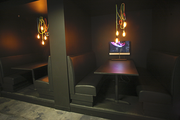 Diner-style booths provide PixelPool employees a quiet place to visit. Light cords provide a rare punch of color.
