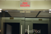 Outside PixelPool's office at 621 S.W. Alder St., a modern Fire Escape sign leads to the building's fire escape.