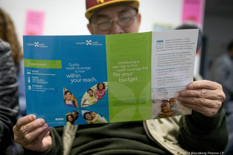 Enrollee Sakoun Khanthanoua reads a Maryland Health Connection health insurance marketplace pamphlet while waiting to speak to a health navigator at an education and enrollment event. The rollout of the program has been widely criticized.