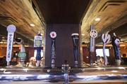 Craft beers are on tap at the bar at The Eagle.