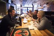 The Eagle co-owner Joe Lanni, left, talks with patrons Rob Torbeck and his wife, Danielle.