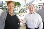 Duane Rhea, right, senior program analyst for the Internal Revenue Service, introduces Gayvial James, the local taxpayer advocate for the  Hawaii and U.S. Pacific Territories at the Department of Commerce and Consumer Affairs Financial Literacy Fair at Tamarind Park in Downtown Honolulu.