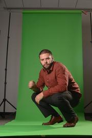 Art director Derek Thomson stands in for lighting on yet another shoot.  See the result here.