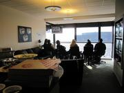 Fans watch the an Oakland Raiders game on Dec. 15 from a luxury suite.