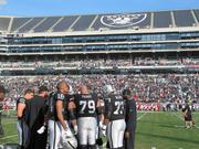 Oakland Raiders players preparing to start a game against the Kansas City Chiefs on Dec. 15, 2013.