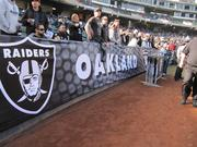 Raiders officials added more signage to boost the team's presence in the stadium.