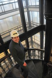Reporter Jim Hammerand touring the historic renovation at the Pioneer-Endicott buildings.