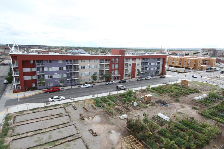 Capstone Real Estate Services has taken on management of two Albuquerque multifamily developments, including Casitas de Colores, far right. Capstone also manages Silver Gardens, in foreground.