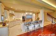 17 Old Governor Place: The kitchen features a breakfast bar and granite counters.