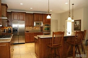 1739 Ciera Ridge Court N: The kitchen features a center island and adjoins a large breakfast room.