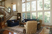 1739 Ciera Ridge Court N: The great room features a two-story wall of windows.