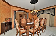 1844 Spring Mill Creek: The dining room. The home features hardwood and tile flooring.