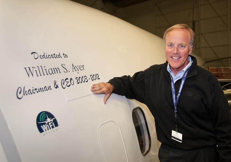 Bill Ayer of Alaska Air Group with an airplane dedicated to him as part of his going-away celebration. Ayer is leaving his job as CEO of Alaska Air gropu.