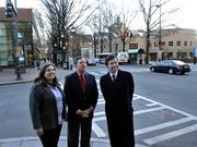 Laura Smith (from left), senior vice president of Foundation For The Carolinas; Lee Keesler, public library CEO; and Michael Smith, president and CEO of Charlotte Center City Partners, stand at the corner of Sixth and North Tryon streets.