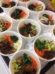 This is food served at the grand opening of a food court at KP International Market in Rancho Cordova. The quick-serve food court has a seating area and offers a variety of cuisine stations, including Mexican, Russian, Chinese, Korean and American foods.