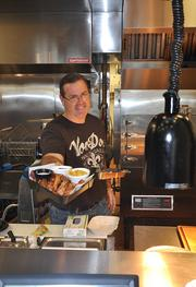 Jack Flechner, above, at the VooDoo BBQ & Grill in Fort Lauderdale.