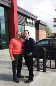 Business partners Johnny Mercado and Andres Garcia at Wendy's.