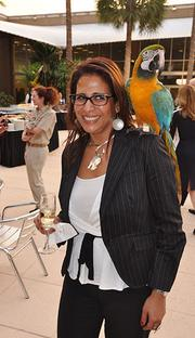 Josie Martinez of Lennar with a blue and gold macaw