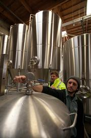 Chris Keeton, right, and Scott Cramlet work on a batch of beer at Rubicon's brewing facility in West Sacramento.