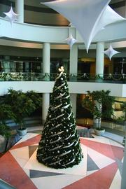 Capella Tower, Minneapolis, has a toy drive for children in need. Property managers at Ryan Cos. US Inc. have musicians perform in the lobby and host a party for tenants. McCaren Designs Inc. designs and installs the holiday decor.