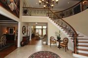 The home's two-story foyer with limestone flooring.