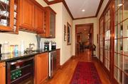 The butler's pantry has granite counters and furniture-style detailing.