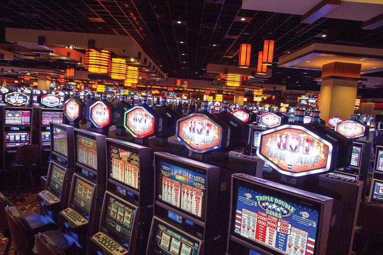 Slot machines are lit up and ready to play inside the Kansas Star Casino, which opened two years ago this month in a facility that is now an events center/arena. The permanent casino, seen here, opened last December.