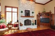 One of four fireplaces in the home, this one is in the family room.