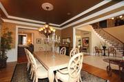The dining room in the Whisperinghill Drive home has double crown molding and hardwood floors.