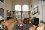 The living room has another fireplace, with marble surround, plus a balcony overlook.