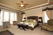The master bedroom includes a large sitting area and French doors that lead out to the private terrace.