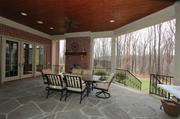 The covered porch has a wood-burning fireplace.