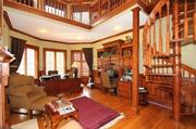 The two-story library has a fireplace and spiral staircase.