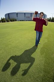 """This frame is not the published shot, but I like its scale and the shadow. Robb Corwin is the """"man behind the curtain"""" at all the functions at University of Phoenix Stadium in Glendale. His company has been setting up for all the tailgaters and then cleaning up after them. He's had this relationship with all his clients since he started shoveling snow off his neighbors' driveways in Minneapolis back when he was in high school."""
