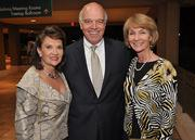 Phillis Oeters, chairwoman of the chamber, with Ron Shuffield of EWM Realty International and Anita Shuffield.