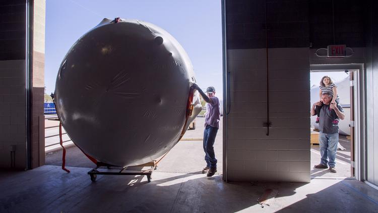 A fermenting tanks that hold 8,172 gallons of beer is installed in 2013 at SanTan Brewing Co.'s 35,000-square-foot facility in Chandler.