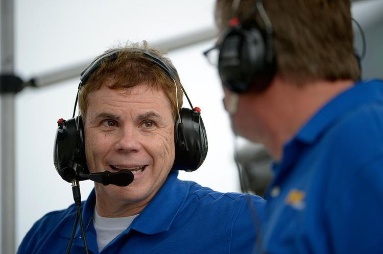 Don Salama, left, talks with James Stevens on the pit cart during testing at the Daytona International Speedway.