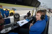 Don Salama, right, talks with James Stevens on the pit cart during testing at the Daytona International Speedway in Daytona Beach, Fla., Wednesday, Nov. 20, 2013.