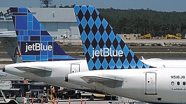 JetBlue wants to have some slots at Reagan National, one of the nation's busiest airports.