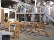 """The tasting room will be the front portion of the 13,000-square-foot building, with communal seating. The brewing area will be blocked off only by a simple chain or gate, allowing visitors to the tasting room to smell, hear and see every part of the brewing process.  """"It's like drinking beer in a factory,"""" said Nick Bowman, head of sales and marketing for the company."""