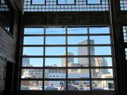 The front glass panels of the building were replaced with a garage door to enable delivery of the massive brewing equipment. Joe Waizmann, president of Warped Wing Brewing Company, said he will open the door when the weather is nice. It provides a nice view of downtown Dayton.