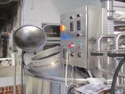 The control panel for the brewing operations at Warped Wing Brewing Company sits on a raised catwalk. Grains spend a few hours in the mash tun before moving to the boil kettle.