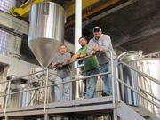 The Warped Wing Brewing Company team stands on the catwalk of the brewery. Left to Right: Joe Waizmann, president, John Haggerty, brewmaster, Nick Bowman, sales/marketing. The fourth partner in the business is Michael Stover, who will handle the company's finances.