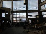 The new garage door provides a view of downtown Dayton while natural light flows in through the glass-block windows original to the 1938 building.