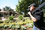 Videographer Raif Fluker shoots video  of a home in Odessa being sold by Wingate &  Associates for $1.98 million.