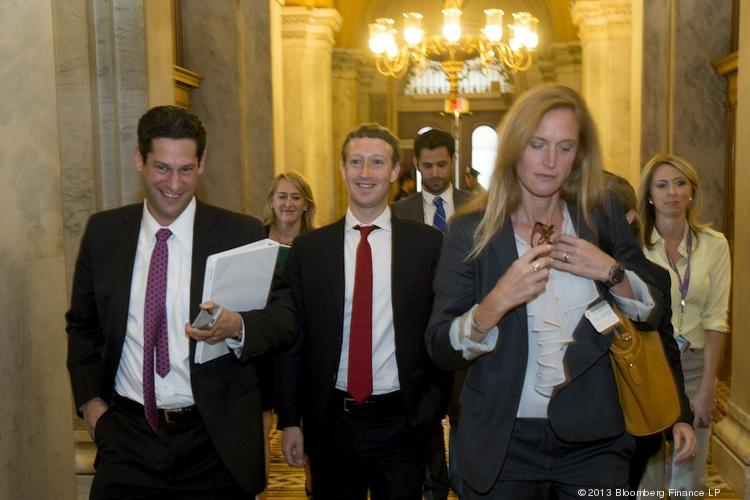 Facebook founder and CEO Mark Zuckerberg, center, walked the halls of the U.S. Capitol in September to lobby for immigration reform.