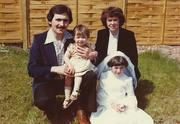 John McAdam and his wife, Liz, in the late 1970s, with their two daughters, Clare (in his arms) and Elizabeth, who was making her First Communion.